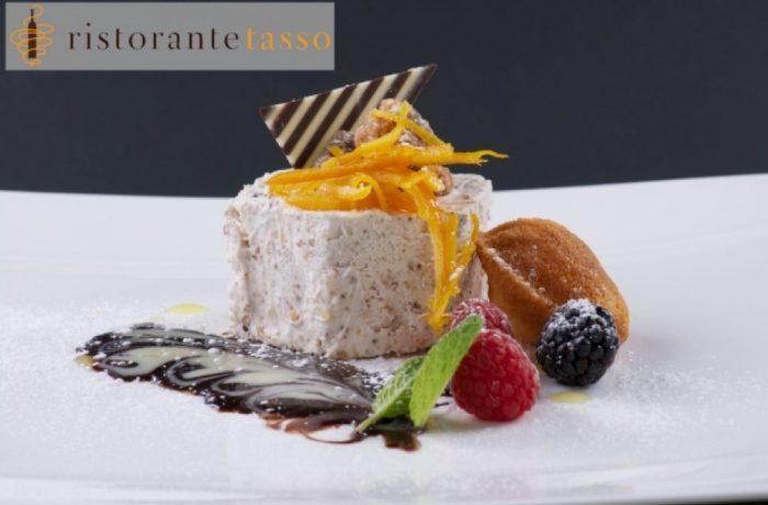 Semifreddo al torroncino con salsa al cioccolato amare e confit d'arancia e magdalena